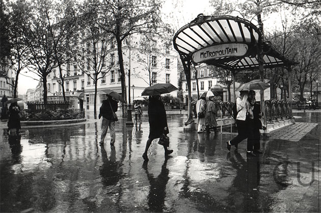 Paris metro place des abbesses in the rain in the 18th arrondisement paris france