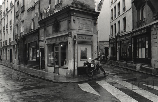 Black and white photo of rue de seine a left bank gallery street in the rain