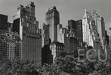 Black and white photo of Central Park South including images of classic New York City skyscrapers designed in the 1920s and 1930s
