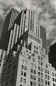Black and white photo of Fifth Avenue in midtown showing the layers of architectural design that have accumulated over the decades in New York