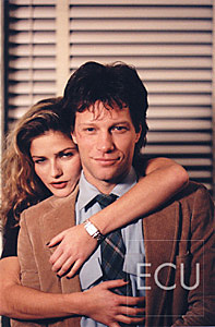 Color photos of the musician and actor Jon Bon Jovi and actress Jill Hennessy during the filming of a movie in New York