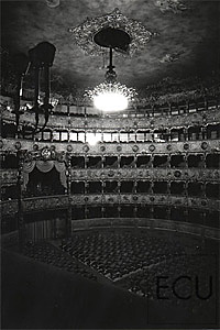 Black and white photo of the interior of the landmark La Fenice theatre before the devastating fire in Venice, Italy