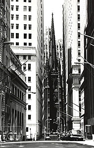 Black and white photo of Wall Street and Trinity Church in Lower Manhattan