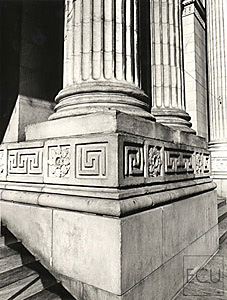 Black and white photo of the stone Beaux Arts architecture of the New York Public Library and its columns on Fifth Avenue