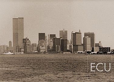Black and white photo of Lower Manhattan skyline shot in the 1970s from the Staten Island ferry featuring the original World Trade Center