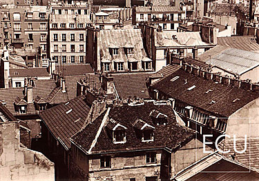 Black and white photo of the rooftops of the Marais section of Paris on right bank taken from rue St. Antoine in Paris, France