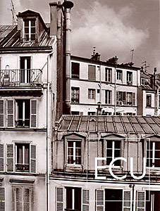 Black and white photo of the rooftops of Paris photographed from the Hotel Chaplain in Montparnasse section of the 6th arrondisement of Paris, France