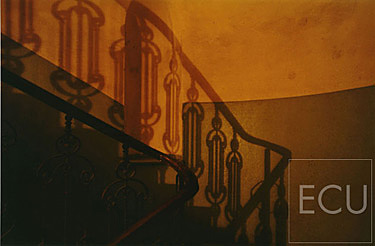 Color photo triptych of a stairs in shadow in Prague in the Czech Republic reflecting Prague's classical architecture