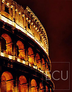 Color photo of the Roman architecture landmark Coliseum shot at night in Rome, Italy
