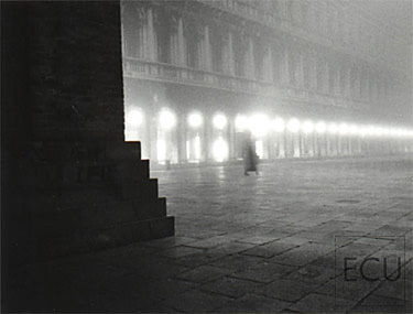 Black and white photo of the Piazza San Marco and the Campanile in the fog in winter, Venice, Italy
