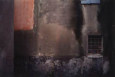 Color photograph of an abstract Venetian wall with a small vented window
