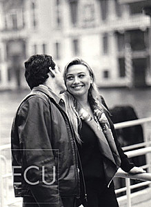 Black and white photos of Vanessa and Mauro on the vaporetto stop of San Toma on the Grand Canal in Venice, Italy