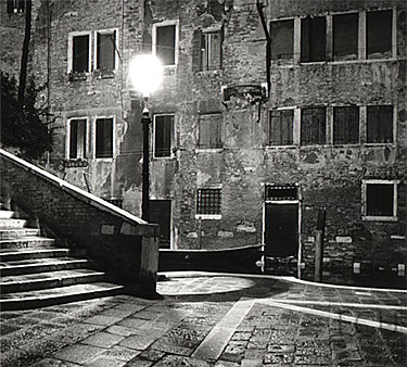 Black and white photo of the Campo San Boldo and bridge in the San Polo sestiere of Venice, Italy