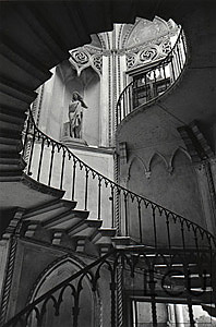 Black and white photo of the interior of the Palazzo Giovanelli featuring a remarkably engineered and designed stair in Venice, Italy