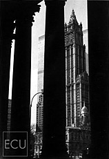 Black and white photo of the landmark Woolworth Building located on Broadway taken from the Municipal Building with views of the original World Trade Center