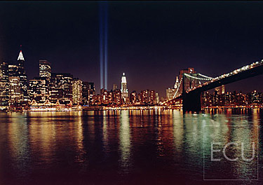 Color photograph taken at night of the Tribute in Light memorializing the original destroyed World Trade Center in Manhattan, New York